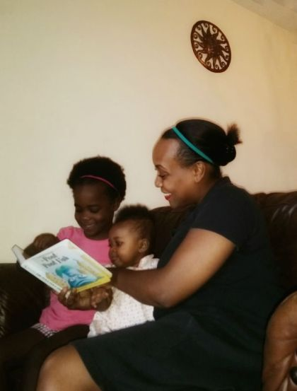 Shana Swain reading to her kids